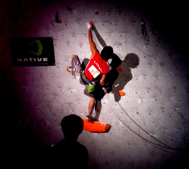 Canadian Sean Mccoll's training pays off as he attempts to Onsight a 5.14 during the Men's Finals at the Boulder World Cup...